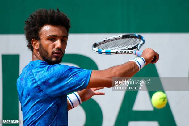 France's Maxime Hamou returns the ball to Uruguay's Pablo Cuevas during their tennis match at the Roland Garros 2017 French Open on May 29 2017 in...