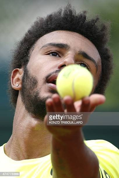France's Maxime Hamou serves against Poland's Jerzy Janowicz during the men's first round of the Roland Garros 2015 French Tennis Open in Paris on...