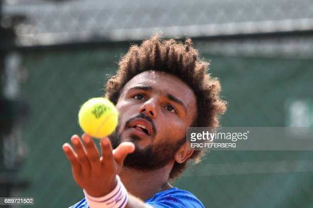 France's Maxime Hamou serves the ball to Uruguay's Pablo Cuevas during their tennis match at the Roland Garros 2017 French Open on May 29 2017 in...