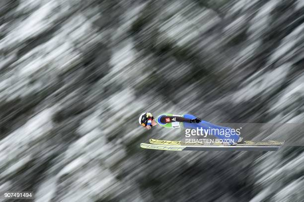 France's Maxime Laheurte competes during the Men's Gundersen of the FIS Nordic Combined World Cup in ChauxNeuve eastern France on January 20 2018 /...
