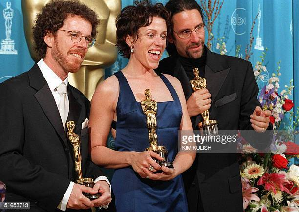 Frances McDormand Best Actress Oscar winner for her role in Fargo poses with her husband Joel Coen and his brother Ethan Coen who jointly won the...