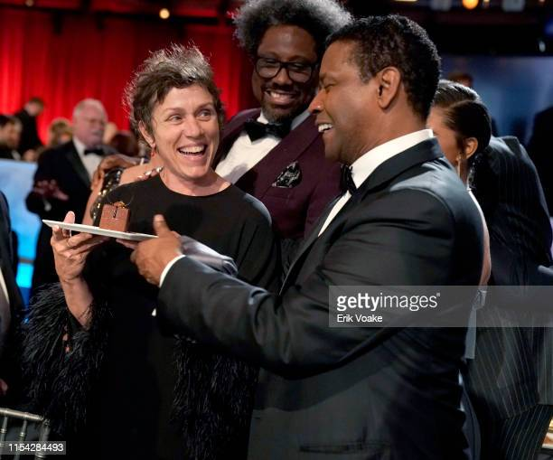 Frances McDormand W Kamau Bell and Denzel Washington attend the 47th AFI Life Achievement Award honoring Denzel Washington at Dolby Theatre on June...