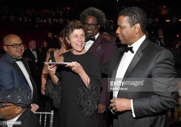 Frances McDormand W Kamau Bell and honoree Denzel Washington attend the 47th AFI Life Achievement Award honoring Denzel Washington at Dolby Theatre...