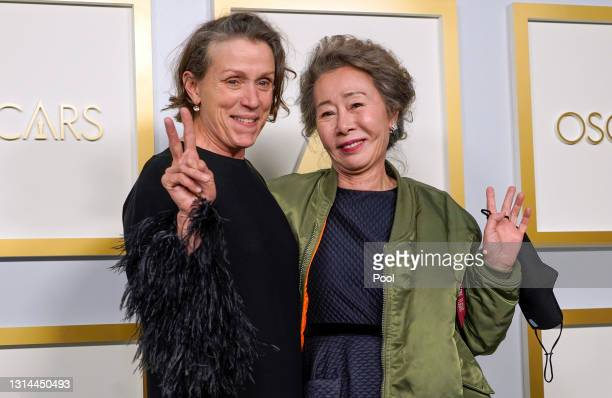 """Frances McDormand, winner of Best Actress in a Leading Role for """"Nomadland,"""" and Yuh-Jung Youn, winner of Best Actress in a Supporting Role for..."""
