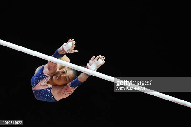 TOPSHOT France's Melanie De Jesus competes on the uneven bars in the women's team final of the artistic gymnastics at the SSE Hydro during the 2018...