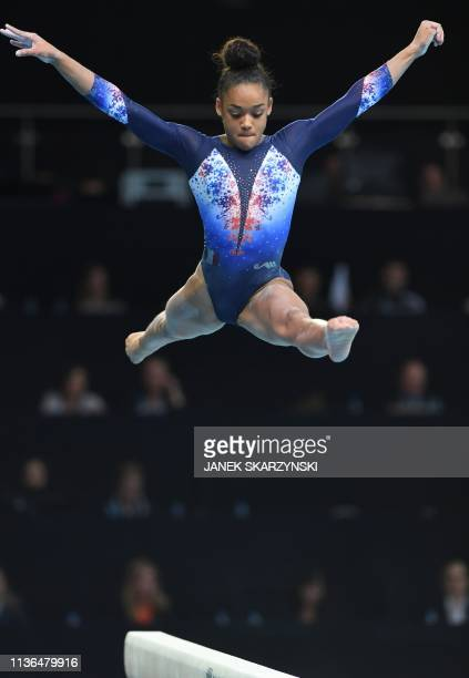 France's Melanie De Jesus Dos Santos performs at the balance beam during the Women's AllAround final during the Artistic Gymnastics Championships in...