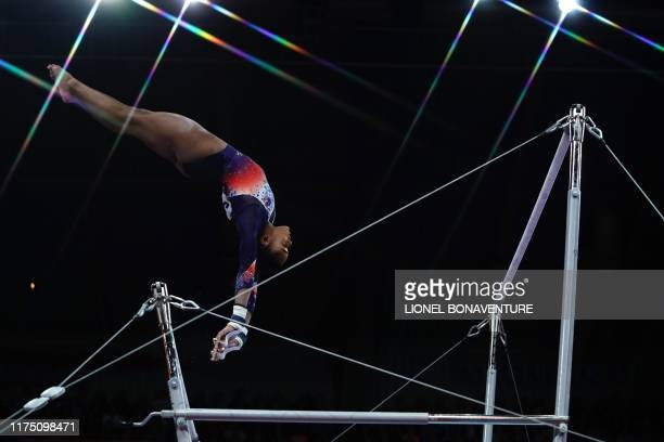 France's Melanie De Jesus Dos Santos performs on the uneven bars during the women's allaround final at the FIG Artistic Gymnastics World...