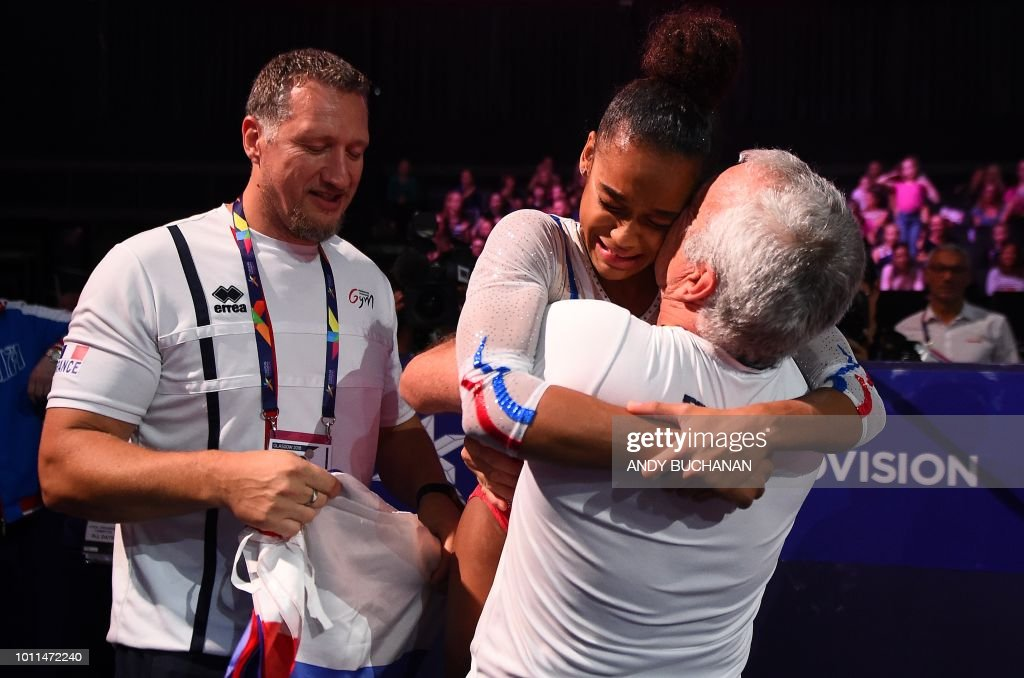 TOPSHOT - France's Melanie De Jesus (C) reacts after taking gold in the women's floor final of the artistic gymnastics at the SSE Hydro during the 2018 European Championships in Glasgow on August 5, 2018.