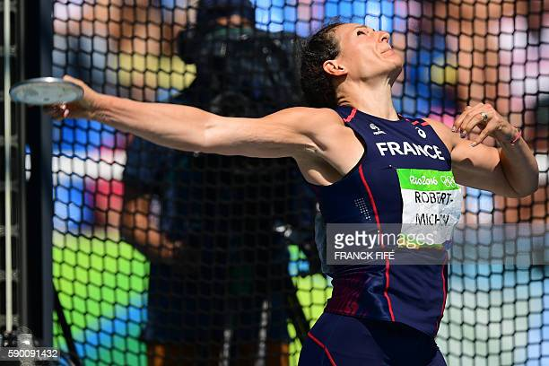 France's Melina RobertMichon competes in the Women's Discus Throw Final during the athletics competition at the Rio 2016 Olympic Games at the Olympic...