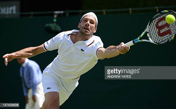 France's Michael Llodra plays a forehand shot during his second round men's doubles match with France's Arnaud Clement against Britain's Jamie Murray...