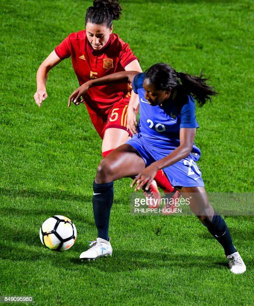 France's midefielder Kadidiatou Diani vies with Spain's defender Ivana Andres during their friendly game football match France vs Spain on September...