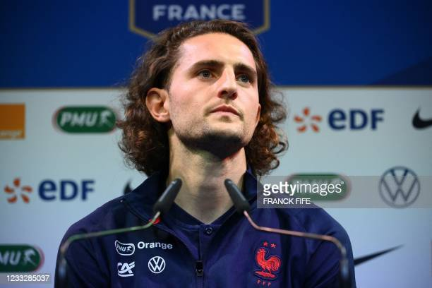 France's midfielder Adrien Rabiot looks on during a press conference in Clairefontaine-en-Yvelines on June 5, 2021 as part of the team's preparation...