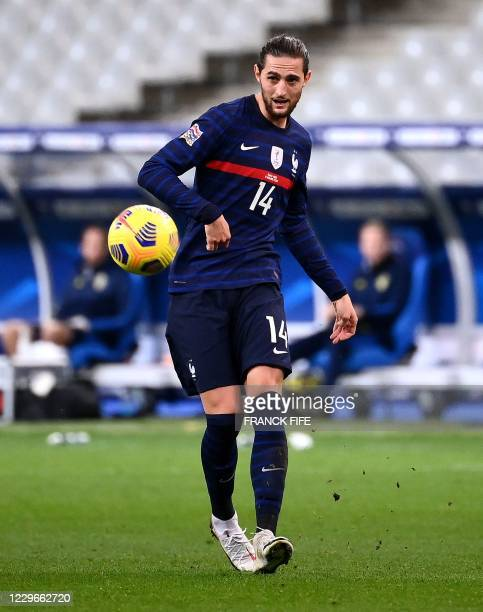 France's midfielder Adrien Rabiot passes the ball during the UEFA Nations League A group 3 football match between France and Sweden at the Stade de...