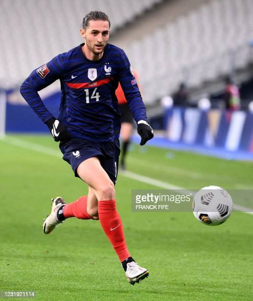 France's midfielder Adrien Rabiot plays the ball during the FIFA World Cup Qatar 2022 qualification football match between France and Ukraine at the...