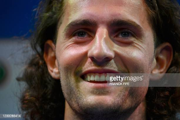 France's midfielder Adrien Rabiot smiles during a press conference in Clairefontaine-en-Yvelines on June 5, 2021 as part of the team's preparation...