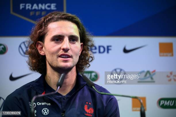 France's midfielder Adrien Rabiot speaks during a press conference in Clairefontaine-en-Yvelines on June 5, 2021 as part of the team's preparation...
