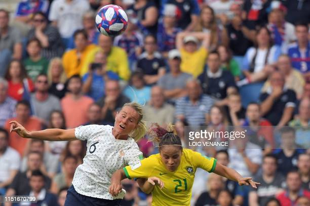 TOPSHOT France's midfielder Amandine Henry and Brazil's defender Monica during the France 2019 Women's World Cup round of sixteen football match...
