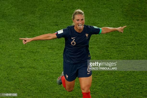 France's midfielder Amandine Henry celebrates scoring her team's fourth goal during the France 2019 Women's World Cup Group A football match between...