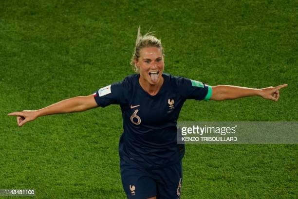 TOPSHOT France's midfielder Amandine Henry celebrates scoring her team's fourth goal during the France 2019 Women's World Cup Group A football match...