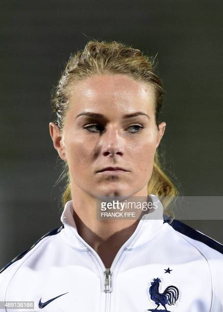 France's midfielder Amandine Henry poses during the French national anthem during the friendly football match France vs Canada on April 9 2015 at the...