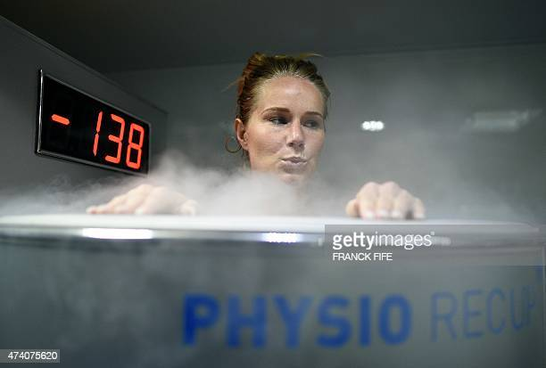 France's midfielder Amandine Henry reacts as she undergoes treatment in a medical device used for cryotherapy at the French national football team...