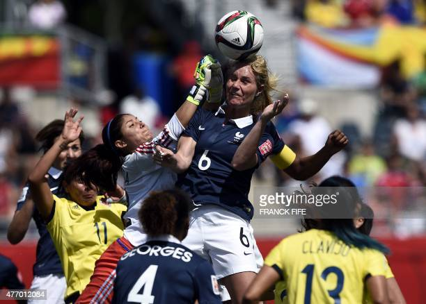 France's midfielder Amandine Henry vies with Colombia's goalkeeper Sandra Sepulveda during a Group F match at the 2015 FIFA Women's World Cup between...