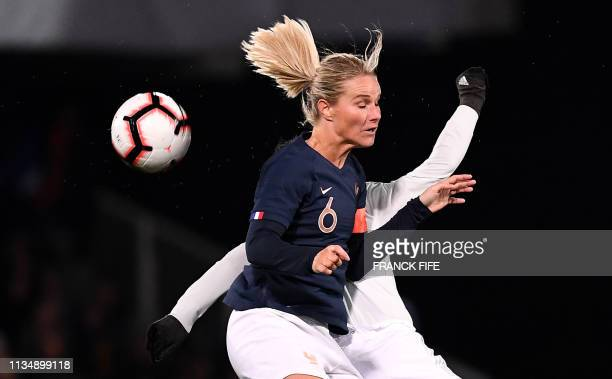 TOPSHOT France's midfielder Amandine Henry vies with Japan's forward Kumi Yokoyama during the FIFA international friendly football match between...