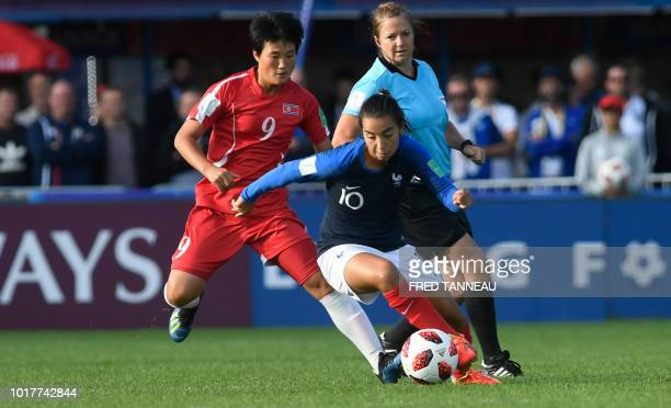 France's midfielder Annahita Zamanian vies for the ball with Korea DPR's midfielder Pom Ui Kim during the Women's World Cup 2018 U20 football match...
