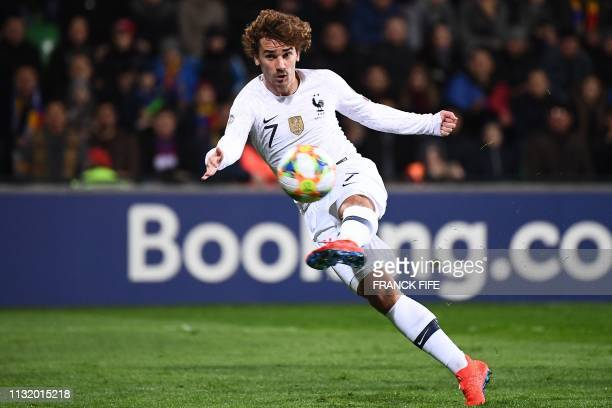 TOPSHOT France's midfielder Antoine Griezmann kicks to score a goal during the Euro 2020 qualifying football match between Moldova and France on...