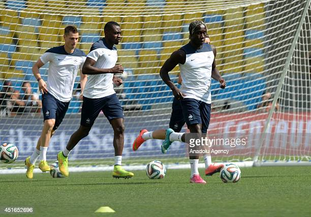 France's midfielder Blaise Matuidi and defender Bacary Sagna attend a training session of French national team at the Maracana Stadium in Rio de...