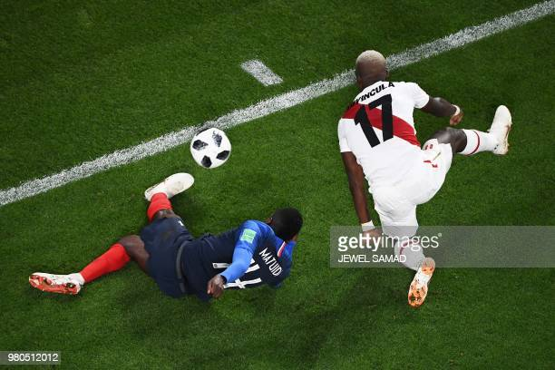France's midfielder Blaise Matuidi and Peru's defender Luis Advincula compete for the ball during the Russia 2018 World Cup Group C football match...