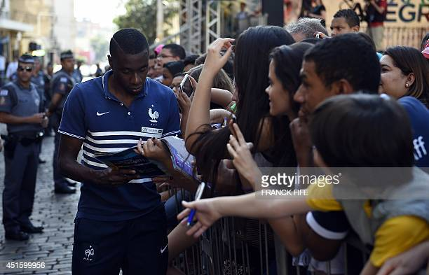 France's midfielder Blaise Matuidi arrives for a press conference at the theater in Ribeirao Preto on July 2 during the 2014 FIFA World Cup in Brazil...