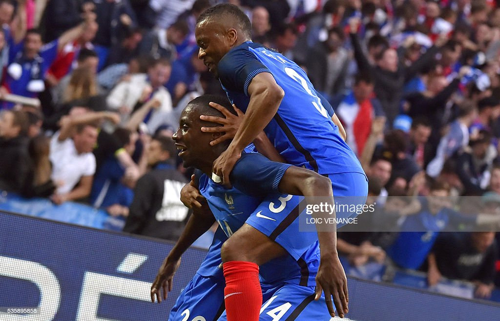 France's midfielder Blaise Matuidi (L) celebrates with his teammate defender Patrice Evra (R) after scoring a goal during the International friendly football match between France and Cameroon at the Beaujoire stadium, in Nantes, western France, on May 30, 2016 as part of the French team's preparation for the upcoming Euro 2016 European football championships. / AFP / LOIC