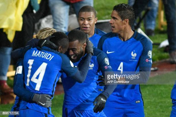 France's midfielder Blaise Matuidi celebrates with teammates after scoring his team's first goal during the FIFA World Cup 2018 qualifying football...