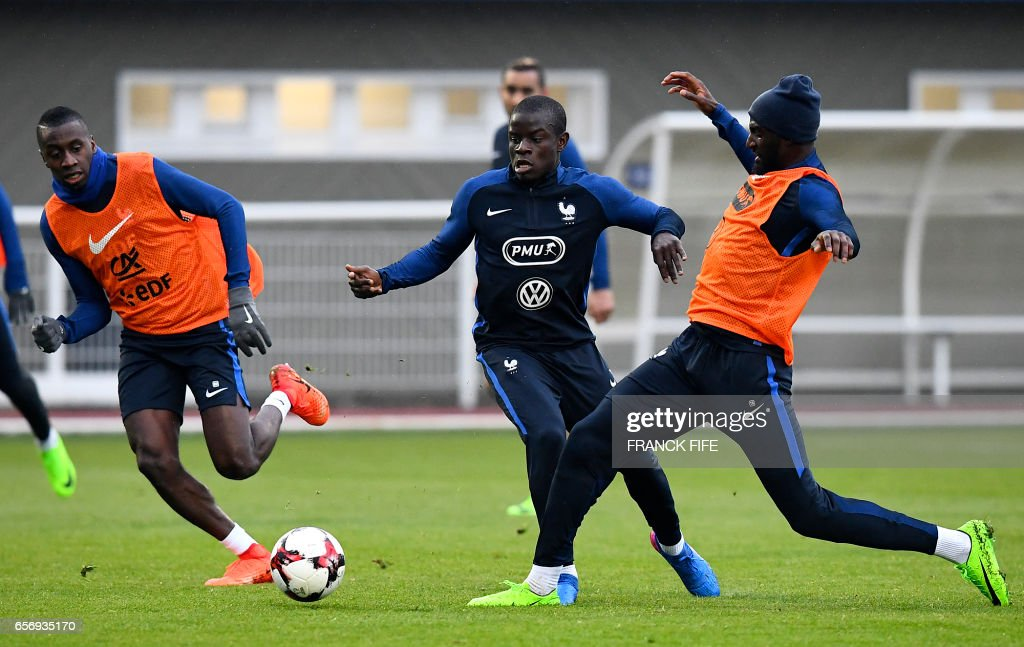 France's midfielder Blaise Matuidi, France's midfielder N'Golo Kante and France's midfielder Tiemoue Bakayoko take part in a training session in Clairefontaine on March 23, 2017, near Paris as part of the team's preparation for the upcoming World Cup 2018 qualifiers. /