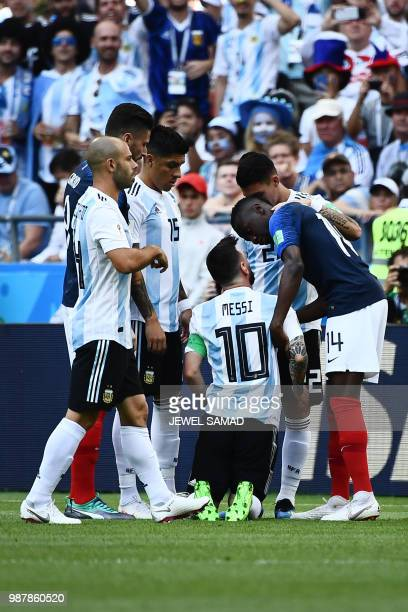France's midfielder Blaise Matuidi speaks with Argentina's forward Lionel Messi during the Russia 2018 World Cup round of 16 football match between...