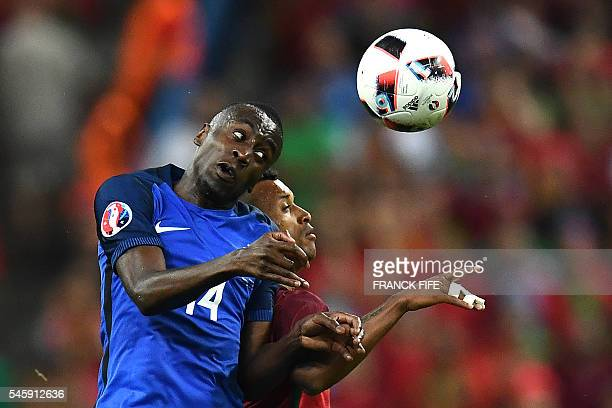 TOPSHOT France's midfielder Blaise Matuidi vies for the ball against Portugal's forward Nani during the Euro 2016 final football match between France...