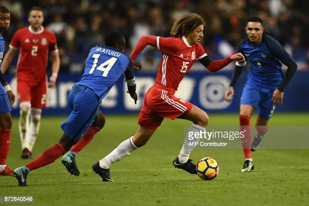 France's midfielder Blaise Matuidi vies for the ball with Wales' defender Ethan Ampadu during the friendly football match between France and Wales at...