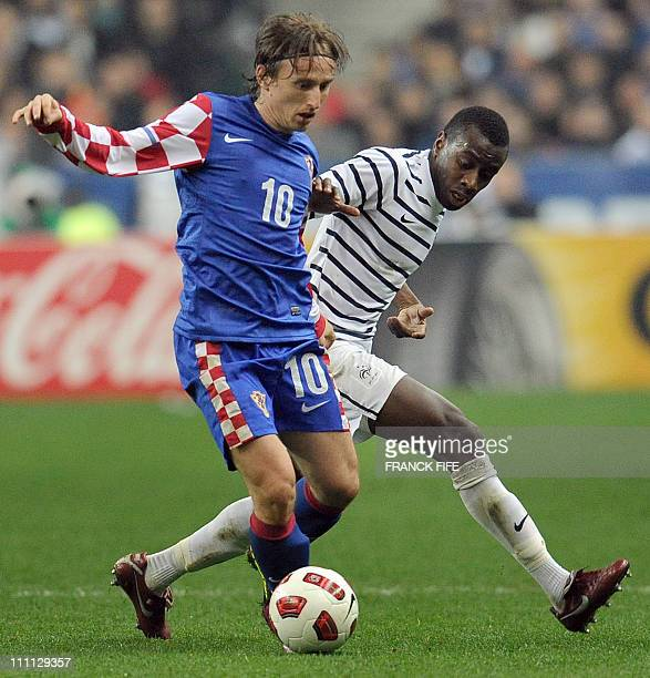 France's midfielder Blaise Matuidi vies with Croatia's midfielder Luka Modric during the friendly football match France vs Croatia on March 29 2011...