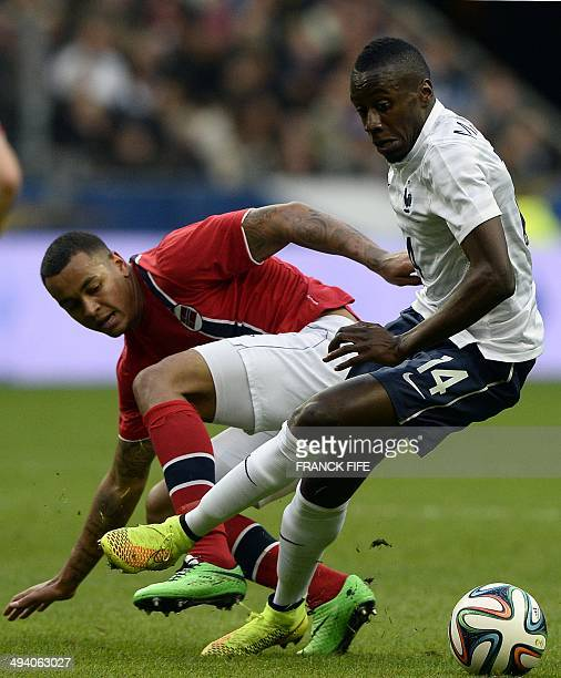 France's midfielder Blaise Matuidi vies with Norway's mdifielder Joshua King during a friendly football match between France and Norway at the Stade...
