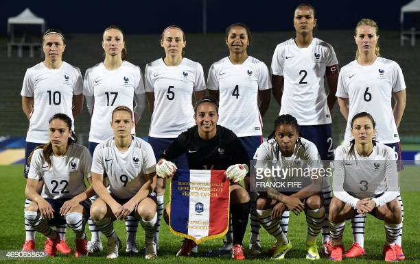 France's midfielder Camille Abily defender Sabrina Delannoy defender Laura Georges defender Wendie Renard and midfielder Amandine Henry France's...