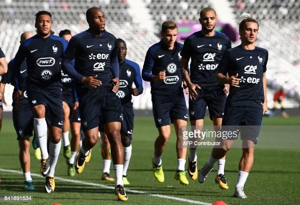 France's midfielder Corentin Tolisso defender Djibril Sidibe defender Christophe Jallet defender Layvin Kurzawa and forward Antoine Griezmann take...