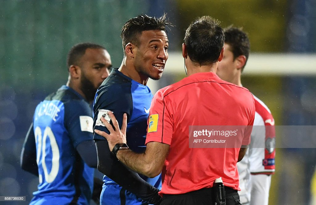 France's midfielder Corentin Tolisso (L) reacts as he speaks with referee Antonio Mateu Lahoz during the FIFA World Cup 2018 qualifying football match between Bulgaria and France at The Vasil Levski Stadium in Sofia on October 7, 2017. /