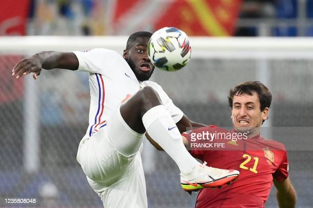 France's midfielder Dayot Upamecano vies with Spain's forward Mikel Oyarzabal during the Nations League final football match between Spain and France...