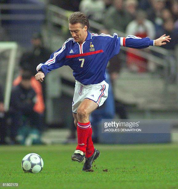 France's midfielder Didier Deschamps runs with the ball during France's friendly match against Poland 23 February 2000 at the Stade de France in...