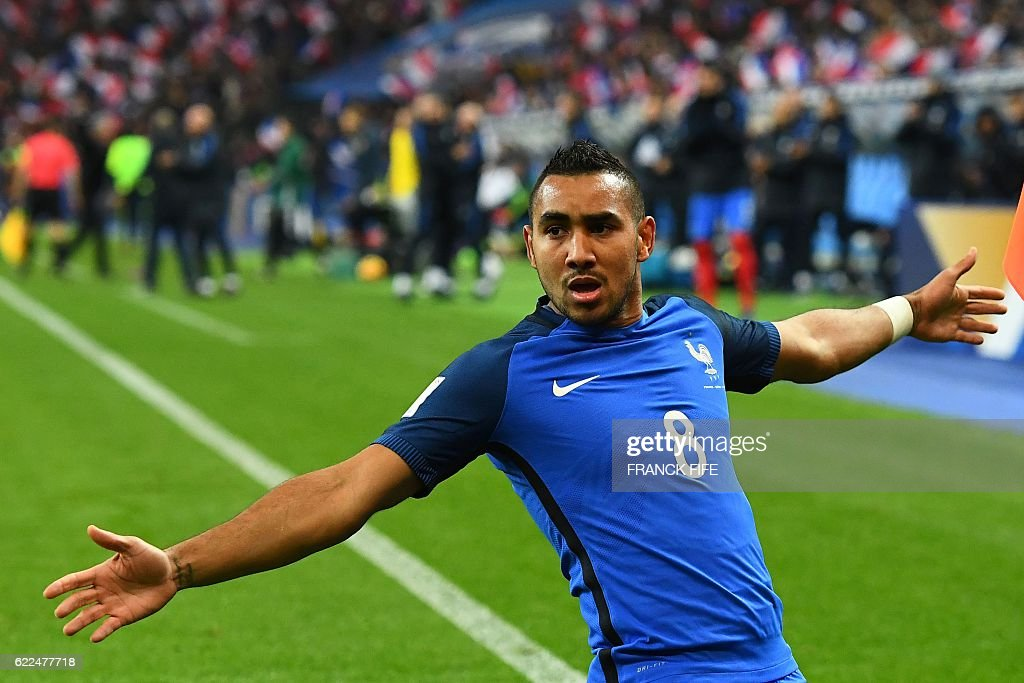 France's midfielder Dimitri Payet celebrates after scoring a goal during the 2018 World Cup group A qualifying football match between France and Sweden at the Stade de France in Saint-Denis, north of Paris, on November 11, 2016. / AFP / FRANCK