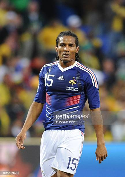 France's midfielder Florent Malouda eyes the ball after scoring during the Group A first round 2010 World Cup football match France vs South Africa...
