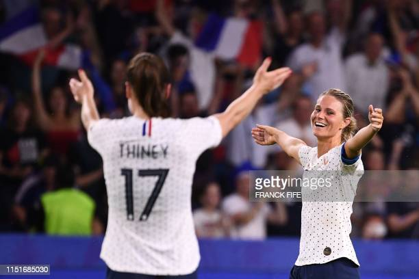 TOPSHOT France's midfielder Gaetane Thiney and France's midfielder Amandine Henry celebrate at the end of the France 2019 Women's World Cup round of...
