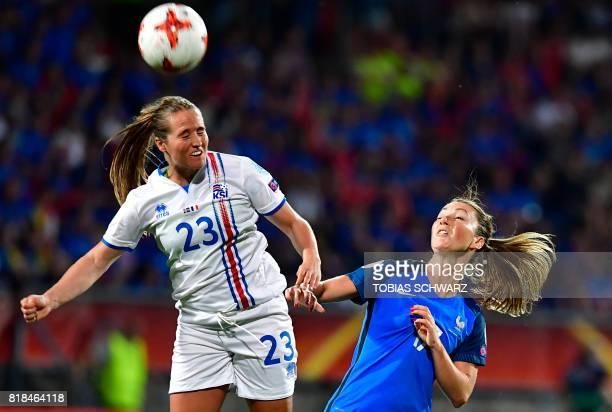 France's midfielder Gaetane Thiney and Iceland's forward Fanndis Fridriksdottir go for a header during the UEFA Women's Euro 2017 football tournament...