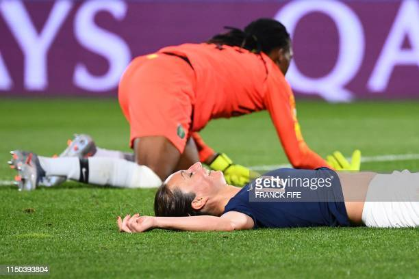 France's midfielder Gaetane Thiney reacts after missing a goal opportunity during the France 2019 Women's World Cup Group A football match between...